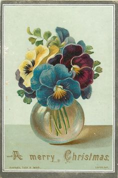 Small clear vase with pansies.
