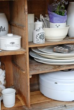 Antique mustard jars, platters and what looks like an amazing roasting pan