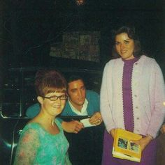 Elvis stopping to sign a few autographs as he leaves his residence, something he did frequently.