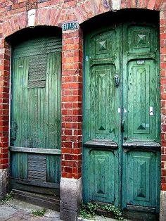 green doors and brick