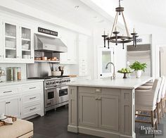 White kitchen with gray island picked by Provident Home Design.