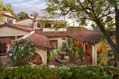 romantic retreat | warm inviting materials | stunning courtyard.