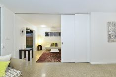 The media room can be closed off completely from the main living area using the stacking doors, which recede into the wall. Stacking Doors, Building Companies, Living Area, Custom Design, New Homes, Budget, Construction, Wall, Room