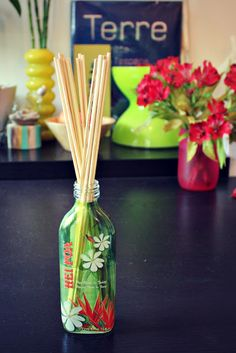 Vase or bottle + baby oil + essential oil + bamboo reeds = DIY reed diffuser