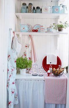 Cute red and aqua kitchen.