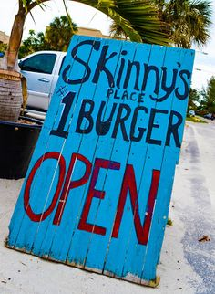 Enjoy a juicy burger and frosted beer at Skinny's Place on Anna Maria Island, Florida.