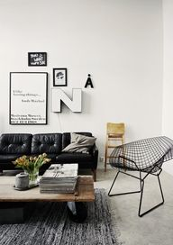 maybe a black tufted couch for the living room with white and wood