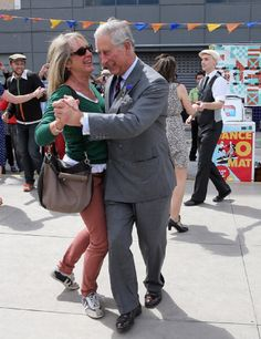 Lisa Shannon and Prince Charles dance at the Dance-O-Mat during a visit to Christchurch on 16 Nov 2012