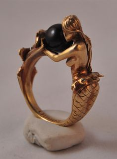 """omniastudios:      """"Arianna"""" art deco inspired mermaid ring.    Available in brass and sterling silver. Arianna holds an 8mm black or white pearl.    Now available for purchase.    www.omniaoddities.com"""