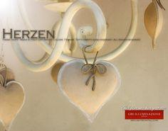 Kronleuchter Herzen, Farbe taupe GBS Kronleuchter Herzen 5 Lichter aus Schmiedeeisen, Farbe taupe. GBS FIRENZE – MADE IN ITALY – Design: Gianni Cresci & Renee Danzer