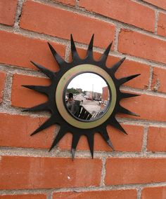 "Indoor Outdoor Wall Mirror. Rustic farmhouse yard art made from salvaged tiller blade cultivator wheel, salvaged spiral gasket & automotive mirror. Unique mirror for home, garden, office or porch. Measures about 9.5"" wide with a 4"" beveled automobile mirror. Weighs approx 1.10 pounds. Painted, varnished & wired to hang in back. Outdoor Walls, Indoor Outdoor, Industrial Mirrors, Unique Mirrors, Garden Office, 10 Pounds, Wall Mirror, Yard Art, Rustic Farmhouse"