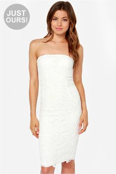 """LuLu*s Exclusive! Nothing quite compares to the way you feel in the First Love Ivory Strapless Lace Dress! Thick ivory crochet lace is any lady's dream as it begins at a strapless bodice with lightly padded cups and a no-slip strip. The ivory lining beneath continues to peek through down a sexy bodycon cut that ends with a midi length. Hidden back zipper/hook clasp. Double lined in stretch knit. Model is 5'9"""" and is wearing a size small. 100% Cotton. Hand Wash Cold. Imported."""