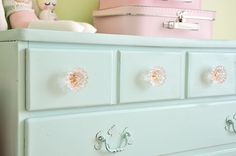 1. Find a dresser 2. Paint the dresser this exact color 3. Find and attach pink jeweled handle knobs!
