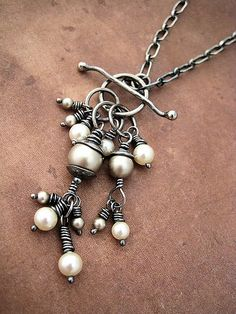 Handmade front closing toggle with wire wrapped pearls. Sterling silver, patinaed.
