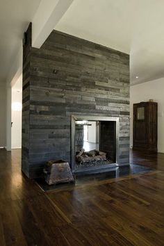 Gorgeous two-sided fireplace with reclaimed wood
