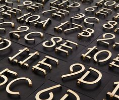hand crafted brass numbers by Frederik Molenschot Signage Design, Wayfinding Signage, Lettering Design, Environmental Graphic Design, Environmental Graphics, Ikea Design, Door Numbers, Sign Display, New York Apartments