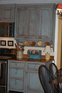 We Painted Our Cabinets Ella Blue Over Brown And Installed Tiger Maple Countertops M Primitive Kitchen Cabinetsdistressed