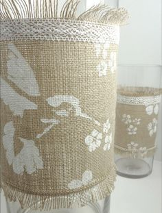 """Stencil on burlap with lace and fringing. Could be done on a burlap table runner or stencil individual letters on square pieces of burlap folded over lengths of twine to make """"Happy _______"""" banners. Burlap: who knew?"""