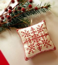 Hey, I found this really awesome Etsy listing at http://www.etsy.com/listing/62813059/cross-stitched-folk-art-ornament