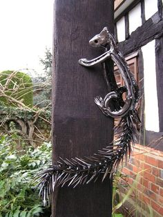 Squirrel!!! Life size horseshoe sculpture by Tom Hill: