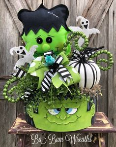 Halloween Centerpiece, Halloween Decor, Halloween Arrangement, Fall Decor, Frankenstein Centerpiece Monster Mash Spooky Fun with Whimsical Flare~ this is one stunning Halloween centerpiece filled with goodies! Ghosts, Pumpkins, Skulls and swirls ~ O My! Frankie was made by very