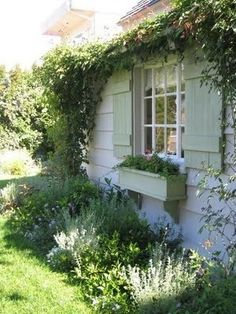 house flower garden 508062401686229499 - instant curb appeal: window boxes (WITH flowers), climbing vines, painted shutters and multipaned windows. Source by Breacadh Garden Types, Diy Garden, Dream Garden, Home And Garden, Garden Beds, Cottage Living, Cottage Style, Cottage House, Painting Shutters
