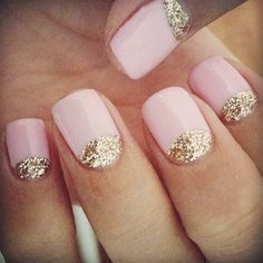light pink nail polish with gold glitter reverse french manicure