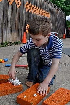 nailing bricks--styrofoam painted orange with golf tees as the nails!