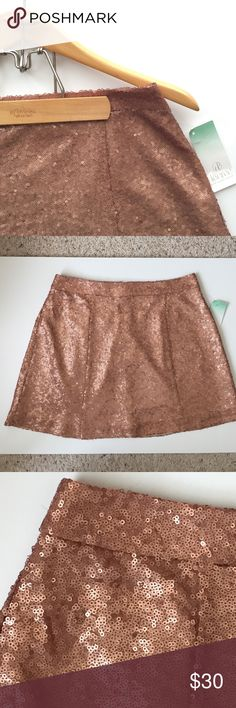 "Fabulous Rose Gold Sequin Skater Skirt NWT Fabulous sequin skater skirt in a rose gold color. Waist 14""; 15"" length. Fully lined. NWT Decree Skirts Mini"
