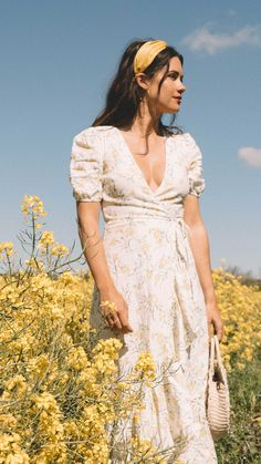 Click to shop outfit + more photos! Sarah Butler of Sarah Styles exploring the beauty of the English Countryside in And Other Stories ruffled linen wrap midi dress and round woven bag. | @sarahchristine