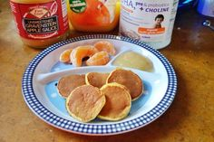 These delicious baby pancakes are made with multigrain baby cereal, apple sauce, and orange ice, among other things.  Try adding chopped fruit for advanced eaters.  Mommies like 'em too, so make a triple batch!