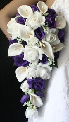White Calla Lily, white babies breath, purple roses, cascading bouquet. Note: Not planning any purple though, but the inter-spaced coloured flowers work to not make the colour too daunting or overpowering.