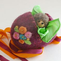 Felt egg with silk & hedgehog inside