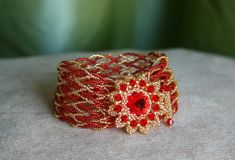 """Tutorial: Bracelet- """"Euphoria"""" by Akara. Netted Cuff w/ Rivoli Focal and Beaded Toggle found at Biser.info - not translated."""