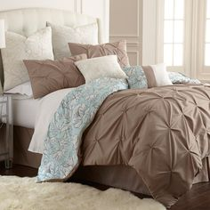 This eight-piece set includes euro shams, decorative pillows, pillow shams, and a tailored bed skirt. An oversized, overfilled comforter completes the set and is wrapped in 100-percent polyester.
