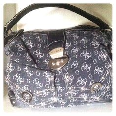 SALE  Guess denim & studded bag Beautiful black denim Guess bag, lots of pockets. Clean in and out. Has a few pen marks inside nothing major, has silver studding throughout bottom leather trim and comes with a fob keychain. Open to reasonable offers Guess Bags Hobos