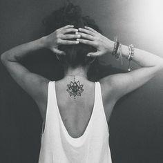 Tattoo - Lotus flower upper back tattoo.