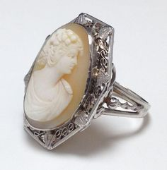 Some clever gal had her antique gold cameo made into a ring in the 1960s.  The original art deco filigree frame is still in wonderful condition around