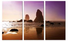Canvas wanddecoratie strand met paarse lucht.
