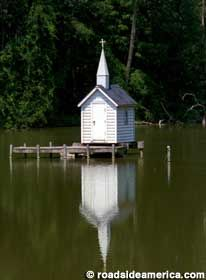 World's smallest church, it holds the bride, the groom and the officiant. Guests can anchor their dinghies around it.