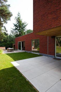 Moderne woning in houtskeletbouw, rode baksteen   Dewaele Houtskeletbouw