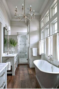 Beautiful grey shiplap and marble I would change the chandieler