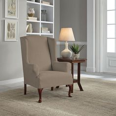The Perfect Fit Faux Suede Wingback Chair Slipcover stretches to fit perfectly over your chair and reverses from a solid to a print with a quick flip of the fabric. An instant style update, it's also machine washable, so you needn't worry about spills. Wingback Chair Slipcovers, Furniture Slipcovers, Home Decor Furniture, Childrens Rocking Chairs, Floor Protectors For Chairs, Wing Chair, Chairs For Sale, Marble Hill, Perfect Fit