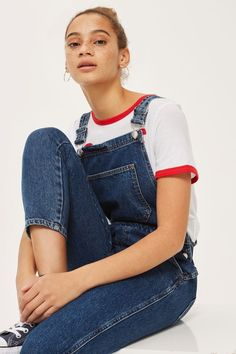 Denim dungarees in a slim leg with a front bib pocket and traditional dungarees styling.