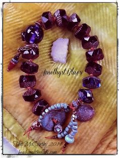 """""""AmethystBlues""""...a mix of cool colors with some orange to contrast. Knotted on pumpkin. Lamp work Ocean Float bead focal."""