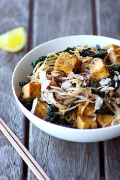 Teriyaki Tofu Soba Noodles with Kale and Coconut! Vegan, gluten free, grain free. A simple and quick recipe from Homespuncapers.com