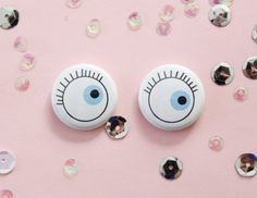 Now you can have a second set of spooky eyes to keep tabs on things! This listing is for two cute eye buttons.    Feel free to message me for a