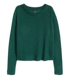Teal green. Knit sweater in soft fabric with ribbing at neckline, cuffs, and hem. Slits at sides.