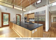 Kitchen In Ultra Modern Home With Black Granite Island   Stock Photo · Navy  Blue ...