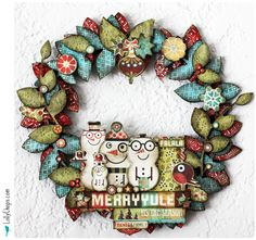 cute scrap paper Christmas wreath.  Tutorial from LollyChops